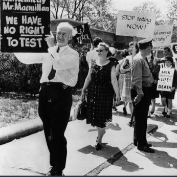 Chemist and Nobel Prize winner Linus Pauling (foreground, left), participating in a demonstration to protest the resumption of U.S. atmospheric nuclear testing, Washington D.C., April 28, 1962.